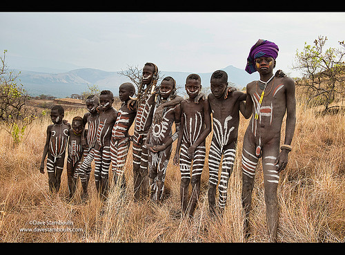 painted Mursi boys in Mago National Park, Lower Omo Valley of Ethiopia