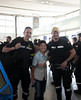 Firefighters pose with a child for a photo. Groups of people cheered and expressed their gratitude as the firefighters made their way through the airport.  Photo: EU/ECHO/V. Rodas