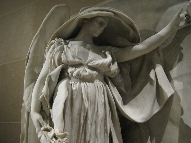 Marble angel mourns 3 brothers