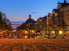 Three bikes on the canal bridge in Amsterdam
