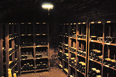 wine(0.0), stall(0.0), stage(0.0), wine cellar(1.0), winery(1.0), lighting(1.0),
