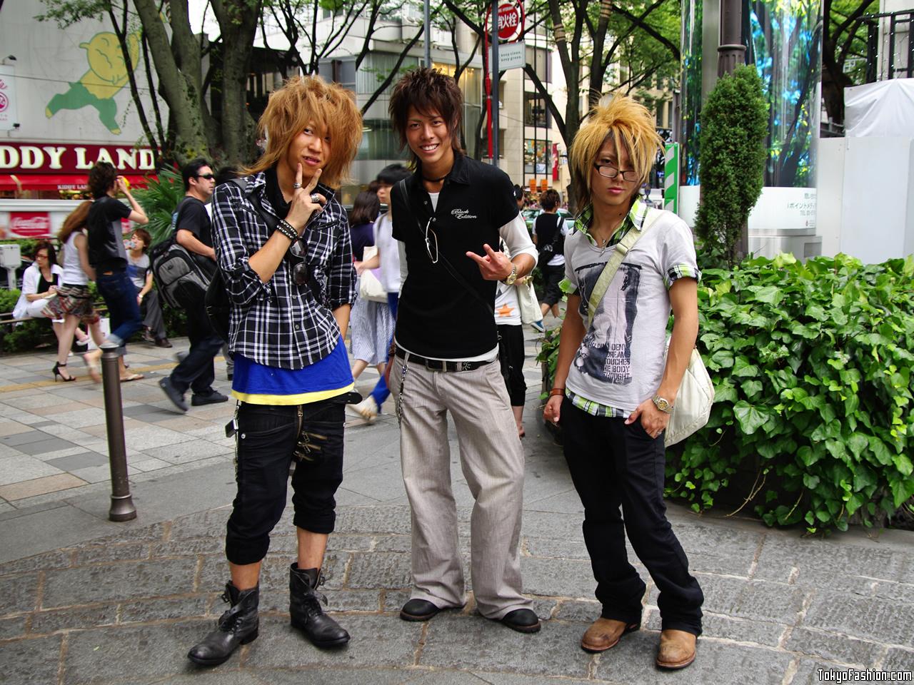 Three japanese guys on the street in omotesando tokyo japan