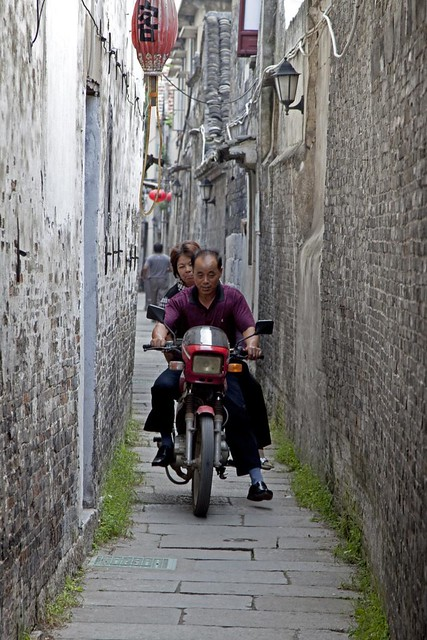 Man and Woman on motorcycle in alley