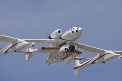WhiteKnightTwo with SpaceShipOne flying at EAA Airventure, Oshkosh, WI. July 2005. credit Jim Kopenick