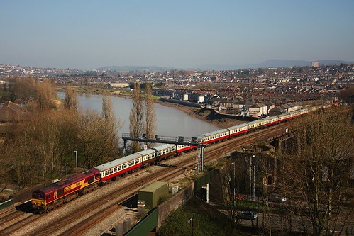 66250 leading 66021 over the River Usk approaching Newport Station working London Paddington - Cwmbargoid 09-03-2014