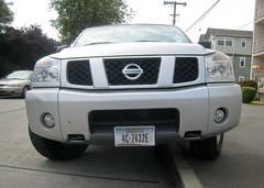 nissan navara(0.0), automobile(1.0), automotive exterior(1.0), sport utility vehicle(1.0), wheel(1.0), vehicle(1.0), nissan armada(1.0), nissan titan(1.0), rim(1.0), grille(1.0), nissan(1.0), bumper(1.0), land vehicle(1.0),
