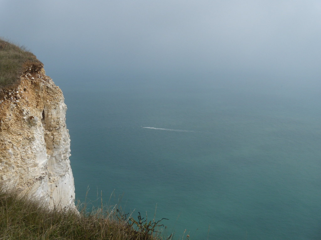 A cliff with a boat Eastbourne to Seaford