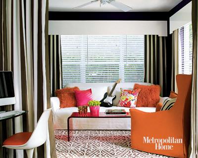 Orange + chocolate: Saarinen chair + geometric carpet, from Met Home