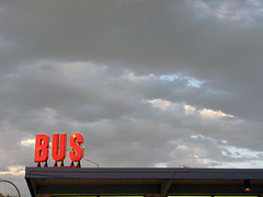 Clouds & Bus Sign