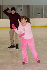 play(0.0), outdoor recreation(0.0), figure skating(0.0), skating(1.0), winter sport(1.0), sports(1.0), recreation(1.0), ice skating(1.0), ice rink(1.0), pink(1.0),