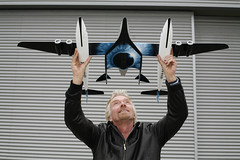Sir Richard Branson and model of VMS Eve and SpaceShipOne. Photograph by Thierry Boccon-Gibod
