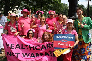 Protest signs: Healthcare not Warfare