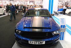 boss 302 mustang(0.0), stock car racing(0.0), automobile(1.0), automotive exterior(1.0), wheel(1.0), vehicle(1.0), performance car(1.0), automotive design(1.0), auto show(1.0), shelby mustang(1.0), land vehicle(1.0), muscle car(1.0), motor vehicle(1.0),
