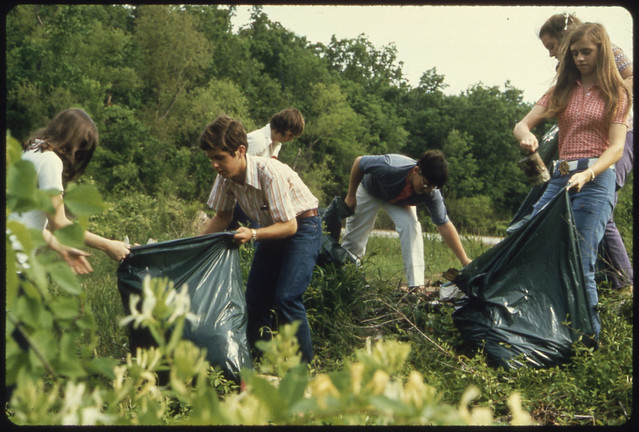 Young People Filling Bags with Litter, by Jim Olive for Documerica. Fort Smith, AR. May, 1972.