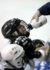 machine(0.0), football--equipment and supplies(0.0), footwear(0.0), football helmet(0.0), goaltender mask(0.0), toy(0.0), protective gear in sports(1.0), hockey protective equipment(1.0), personal protective equipment(1.0), clothing(1.0), sports equipment(1.0), athlete(1.0),