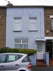 Blue brick house E10