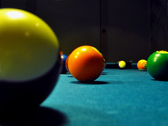 recreation(0.0), nine-ball(0.0), carom billiards(0.0), english billiards(0.0), indoor games and sports(1.0), yellow(1.0), play(1.0), snooker(1.0), sports(1.0), pool(1.0), games(1.0), green(1.0), billiard ball(1.0), eight ball(1.0), ball(1.0), cue sports(1.0),