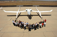 Burt Rutan with the Virgin Galactic Founders and WhiteKnightOne. Credit Claire Brown
