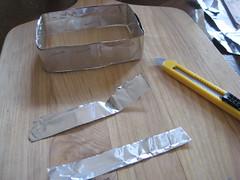 fold tin over sharp edges of mixtape cutter