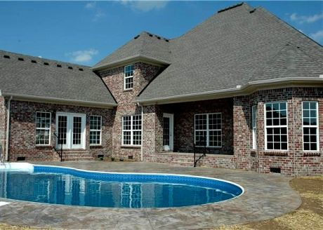 This home featured a pool and large pool room off the rear of the house.
