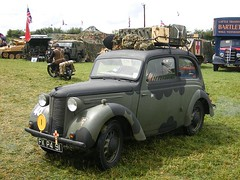 volkswagen beetle(0.0), automobile(1.0), vehicle(1.0), renault juvaquatre(1.0), mid-size car(1.0), subcompact car(1.0), city car(1.0), off-road vehicle(1.0), compact car(1.0), antique car(1.0), sedan(1.0), vintage car(1.0), land vehicle(1.0), motor vehicle(1.0),