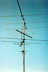 electronic device(0.0), overhead power line(0.0), mast(0.0), wind(0.0), transmission tower(0.0), lighting(0.0), electrical supply(1.0), television antenna(1.0), line(1.0), electricity(1.0), antenna(1.0),