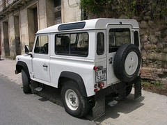 off-roading(0.0), jeep wrangler(0.0), automobile(1.0), automotive exterior(1.0), sport utility vehicle(1.0), vehicle(1.0), compact sport utility vehicle(1.0), land rover defender(1.0), off-road vehicle(1.0), bumper(1.0), land vehicle(1.0),