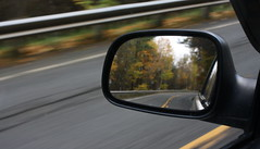 looking into a side mirror