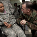 U.S. Navy Adm. Mike Mullen speaks with a victim of the Fort Hood shooting
