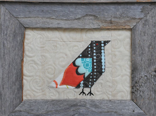 pieced bird in a frame