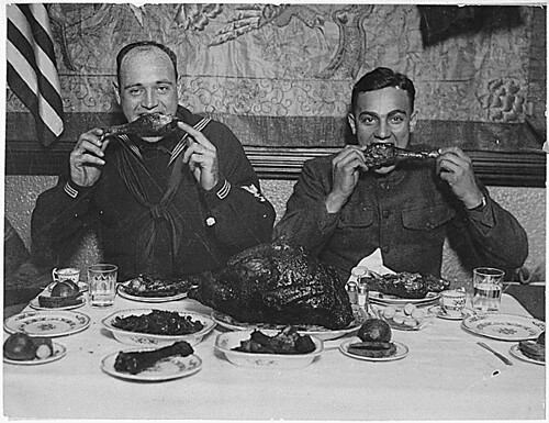 Thanksgiving cheer distributed for men in service. New York City turned host to the boys in service today and cared for every man in uniform. Underwood and Underwood: ca. 1918