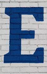 Serifed Blue Capital Letter E On Brick (Silver Spring, MD)