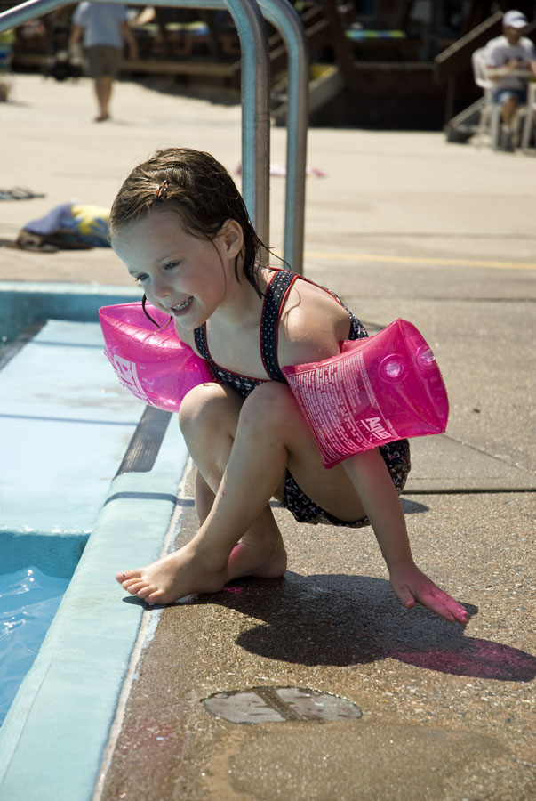 Little Girl With Swimming Flippers At Silver Gull Club