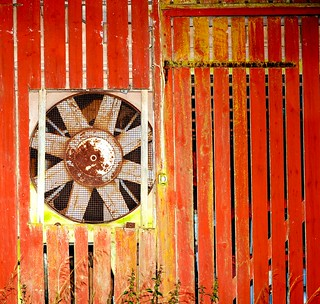 Old barn with a rusty fan