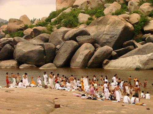 Pilgrims Bathe in the Tungabhadra River - Near Hampi - India