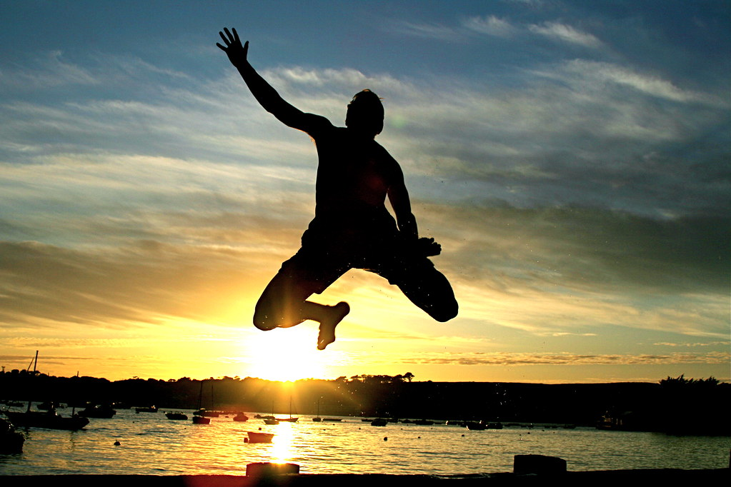 Jumping into the sea at sunset. Using the self timer