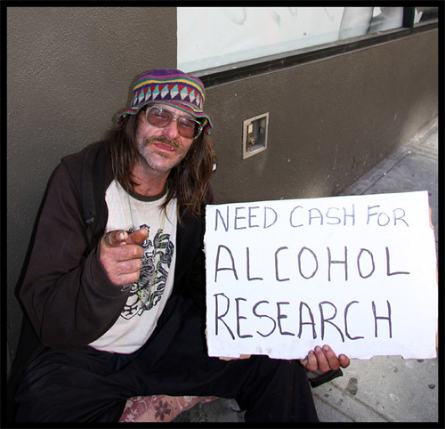 homeless man in san fransisco holds a funny sign flickr