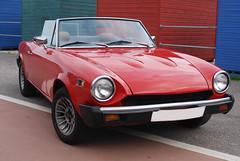 datsun roadster(0.0), compact car(0.0), automobile(1.0), automotive exterior(1.0), vehicle(1.0), sunbeam tiger(1.0), antique car(1.0), classic car(1.0), land vehicle(1.0), convertible(1.0), sports car(1.0),