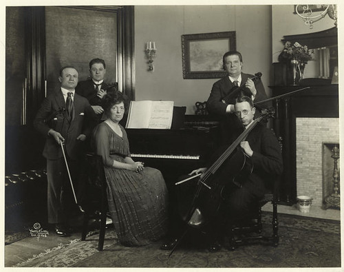 [Music ensemble with piano and bowed stringed instruments.]