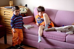 brothers watching sunday morning cartoons on the hot…