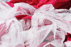 Red Satin and White Lace Fabric