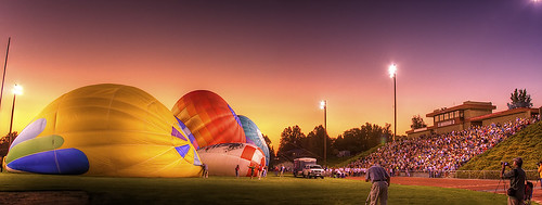 school sunset sky panorama hot field grass festival canon balloons lights washington colorful track stadium vibrant pano air crowd photographers highschool wa footballfield hotairballoons hdr prosser stands mustangs balloonfestival philerooski