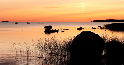 sunset beach landscape rocks rush