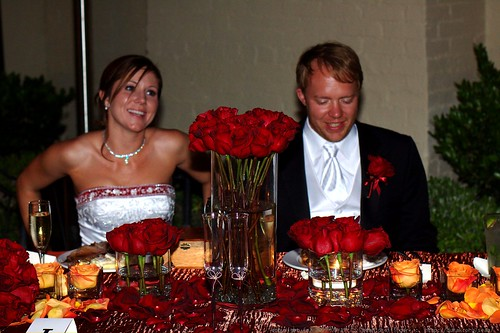 bride and groom sit down to eat    MG 2855