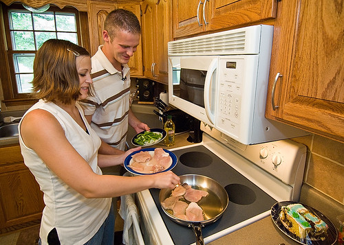 Christopher and Natasha Goetz preparing dinner in their home in Garnett, Kansas. By 2005-08, total fat accounted for 30.5 percent of calories in foods prepared at home, compared with 37 percent in away-from-home foods.