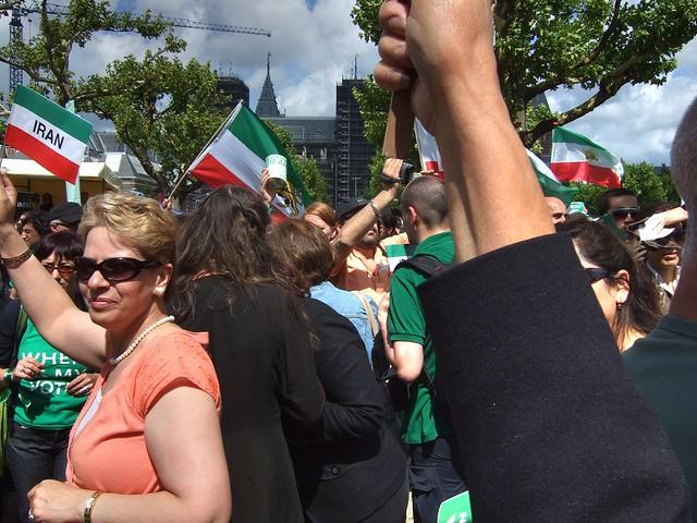 Waving flags, wearing something green