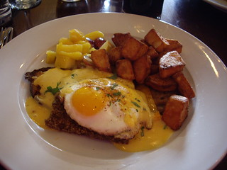 eggs benedict with goetta and chipolte hollandaise