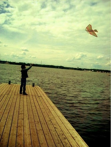 bridge sky kite green silhouette yellow clouds river fly europe alone russia moscow lonely