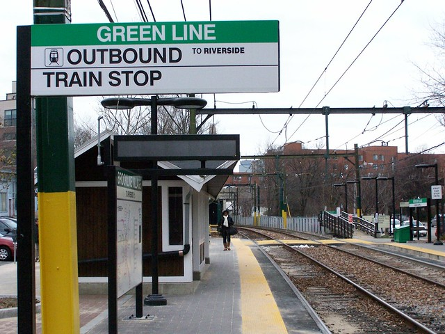 green line outbound train sign