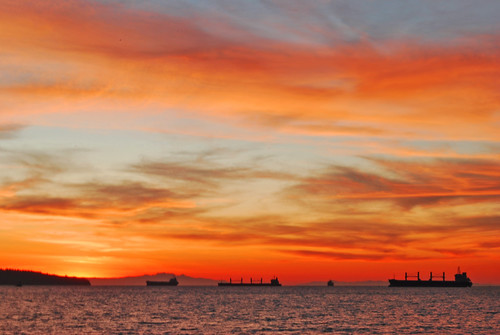 ocean sunset red sky orange sun beach water vancouver clouds boats fire britishcolumbia englishbay stanleypark fiery flickraward cans2s